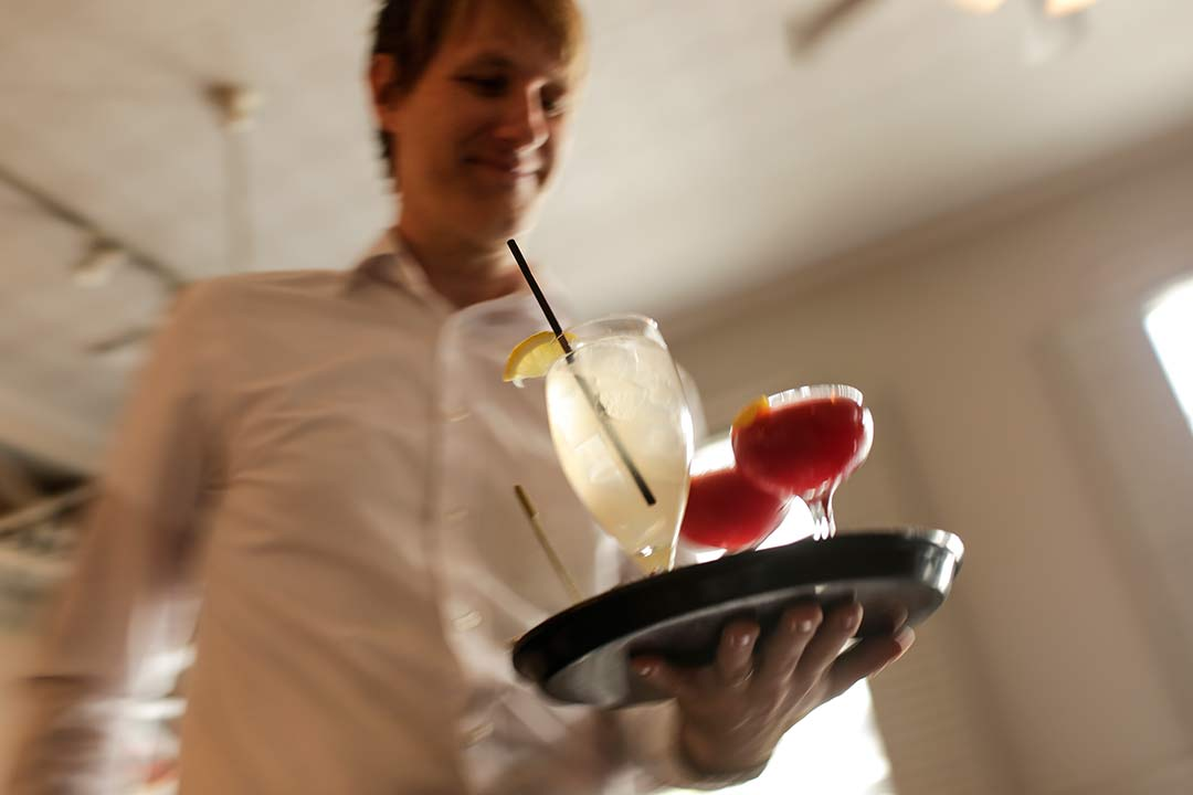 Waiter with drinks on a tray