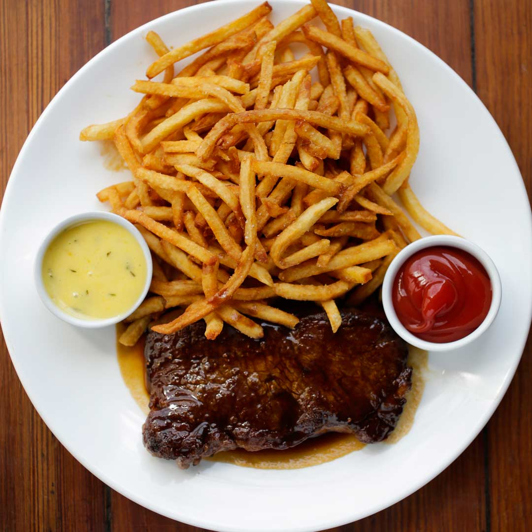 Steak frites plated and ready to eat
